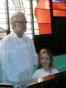 Alight, with Pastor Dan, moments before being baptized.